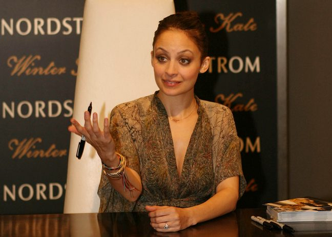 Nicole Richie, brown gold and black sheer blouse, gold bracelets